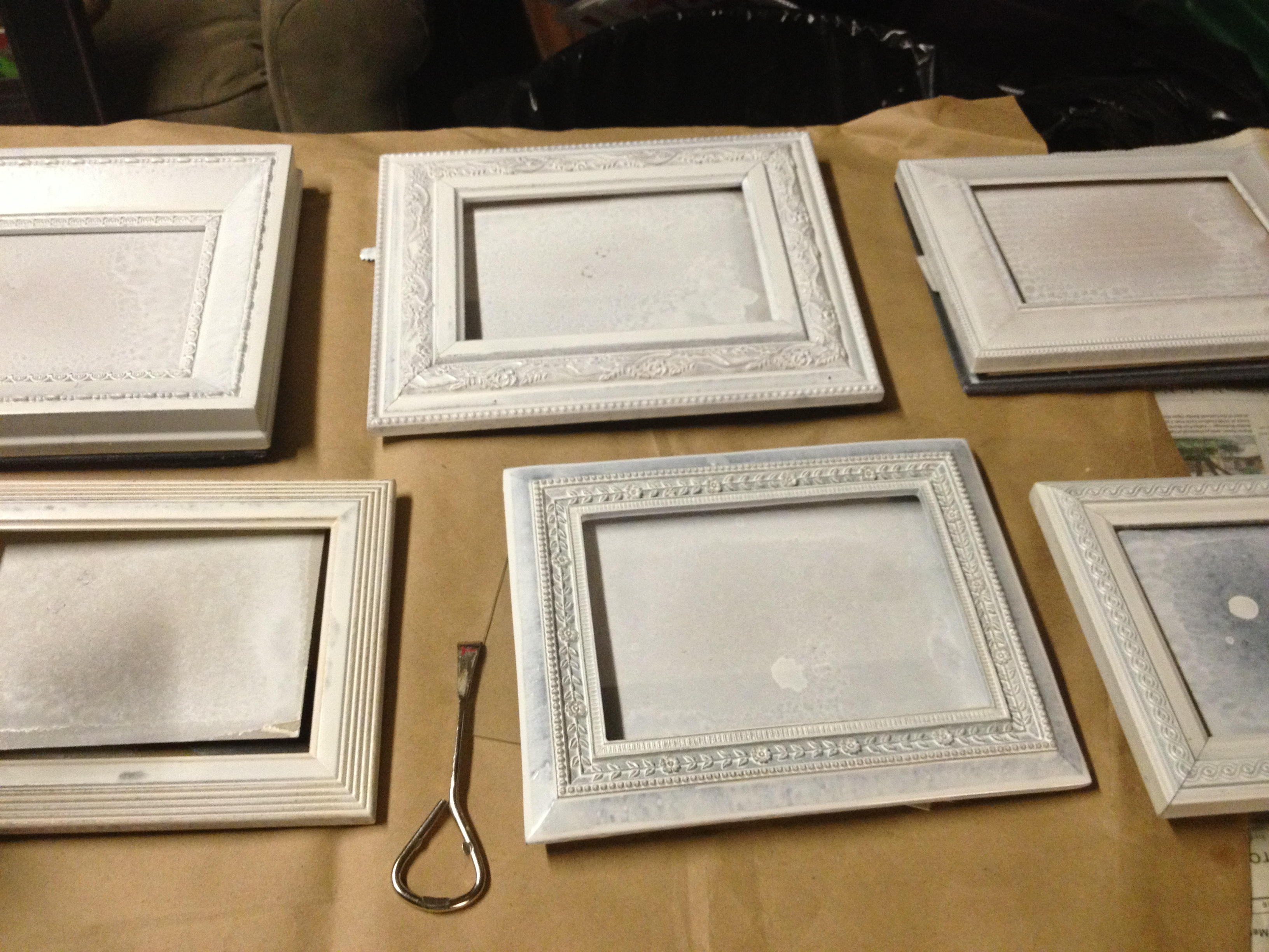 so i went for annie sloan chalk paint in old white for all the frames this paint covers anything i may have been able to make the spray paint work by